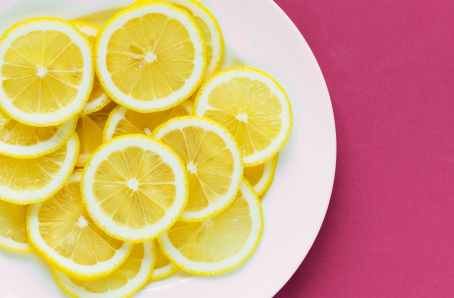 photo of sliced lemons on white plate